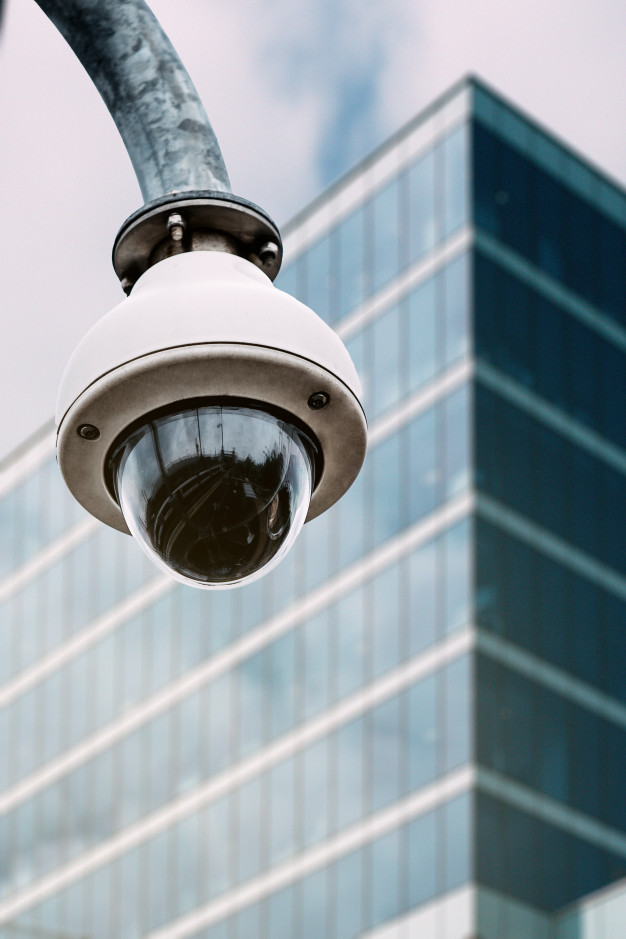 security camera with glass building background